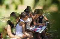 children-reading-under-tree-2
